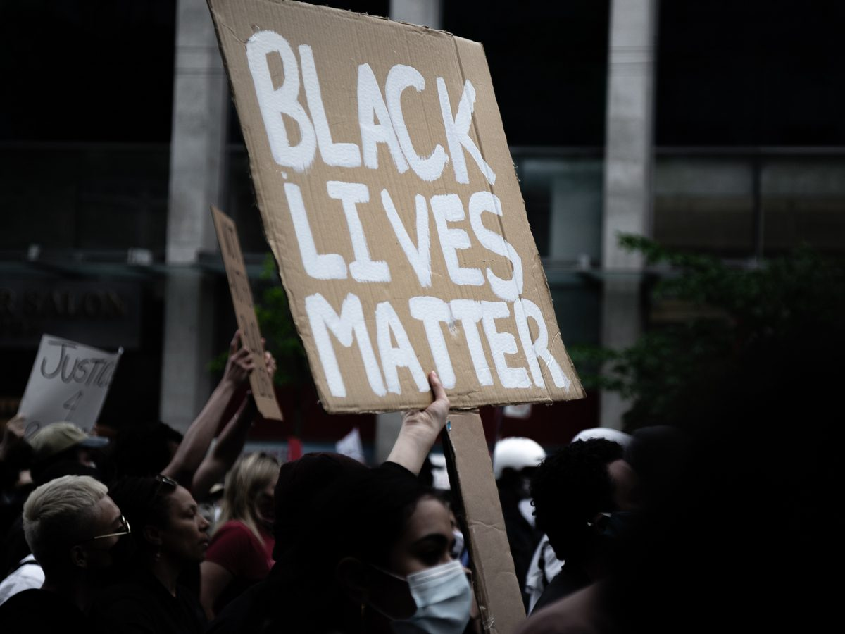 A protestor holds a sign at the Not Another Black Life protest in Toronto on May 30, 2020