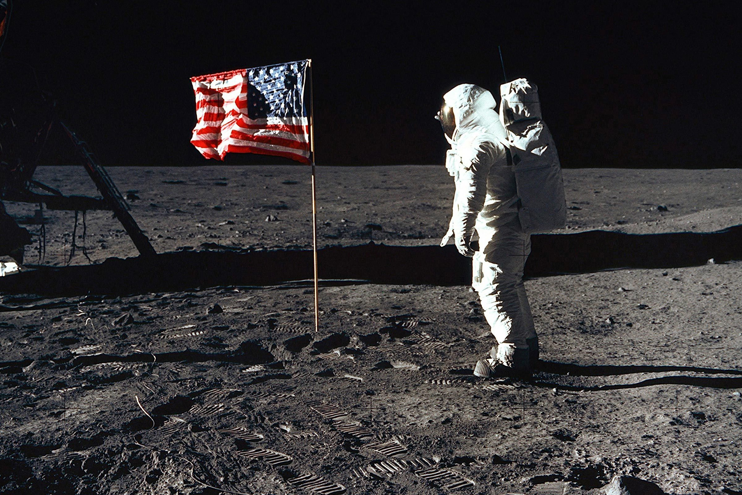 Astronaut Edwin 'Buzz' Aldrin, lunar module pilot of the first lunar landing mission, poses for a photograph beside the U.S. flag during the Apollo 11 mission