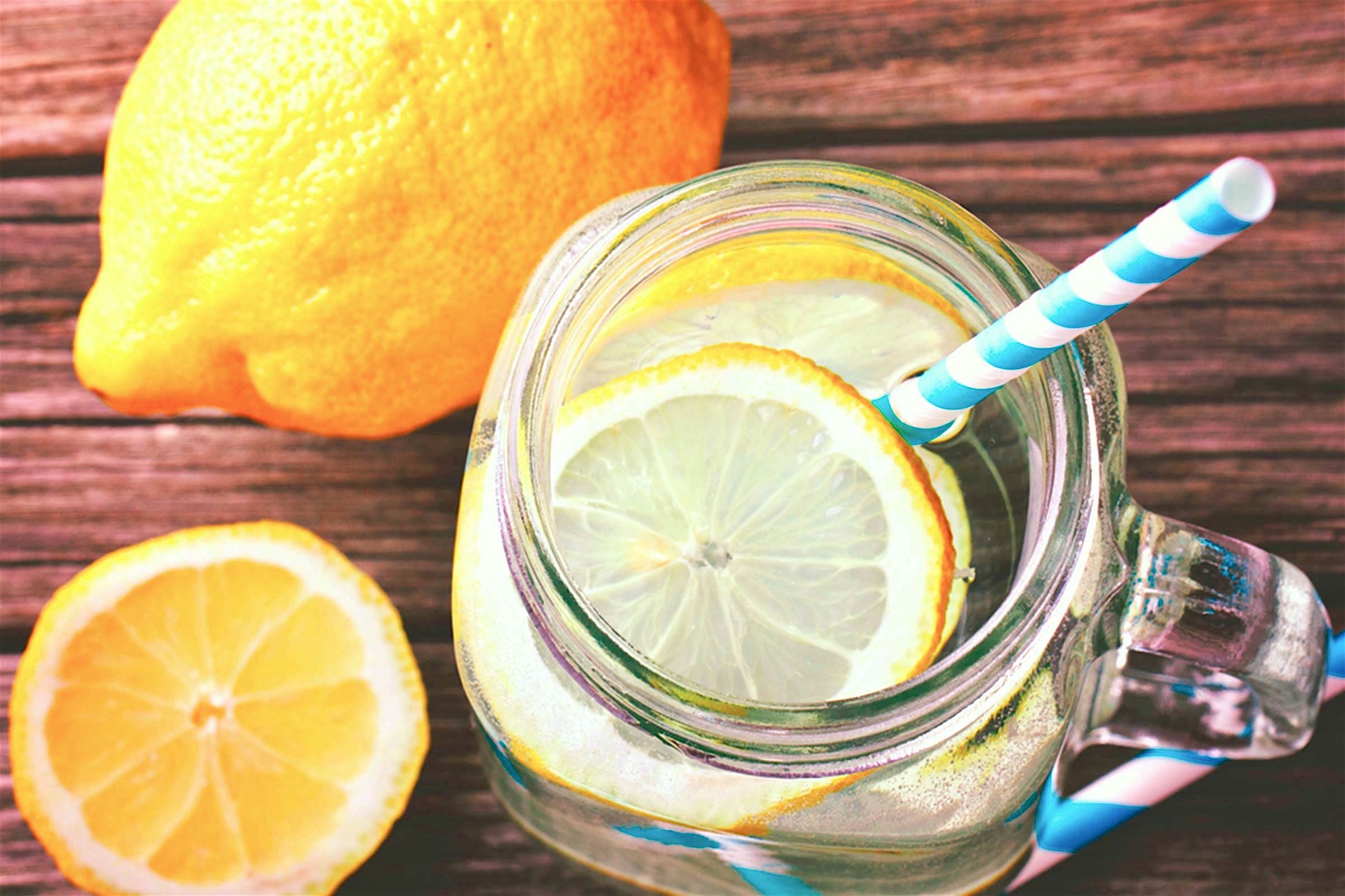 lemon water in jar with straw