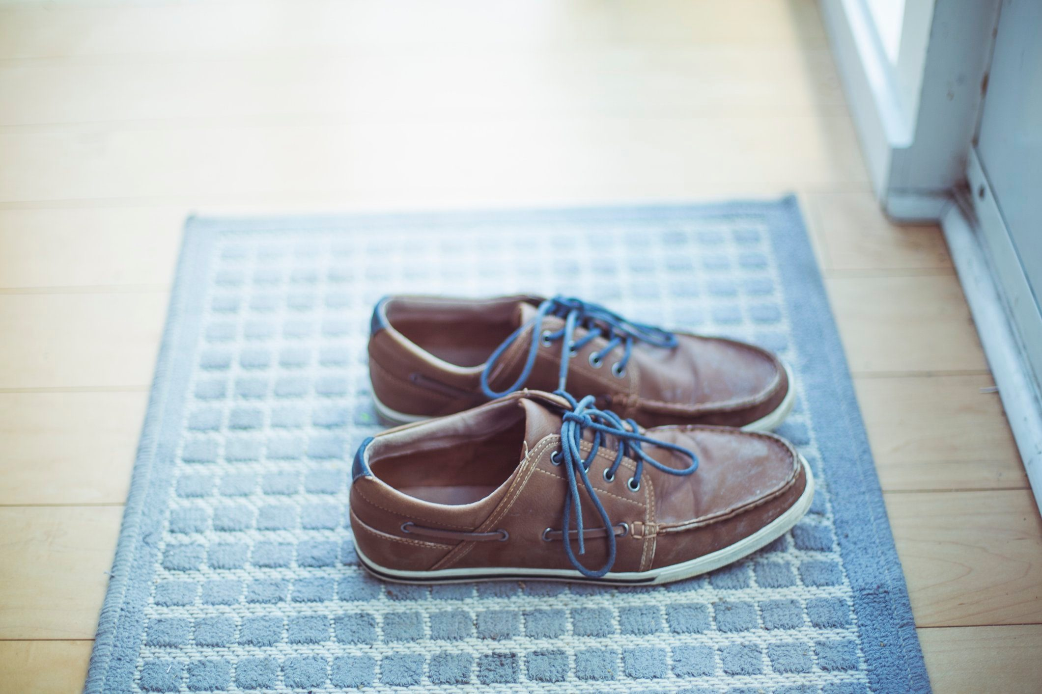 shoes on mat by front door of house