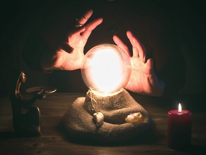 Cases solved by psychics - Crystal ball and fortune teller hands. Divination concept. The spiritual seance. Future reading.