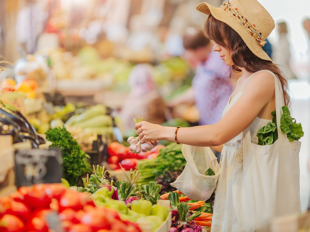 Good news - woman shopping for fresh produce