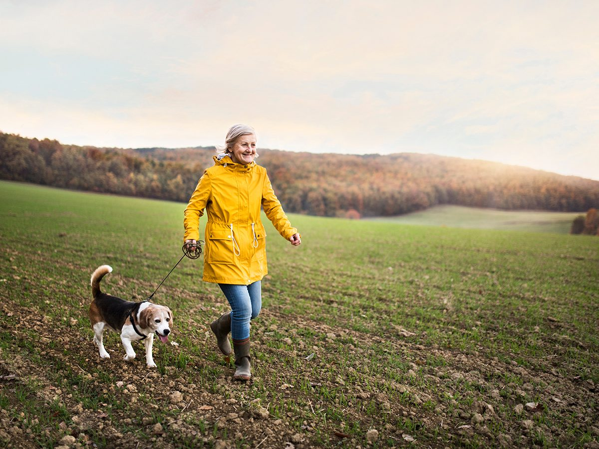 How to make walking less boring - woman walking dog