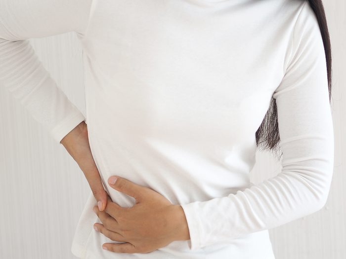 what causes Shingles - woman in pain