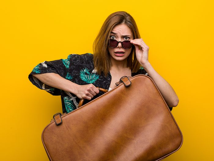 Hilarious tweets - woman with emotional baggage carrying suitcase