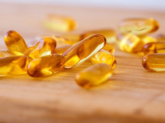 Home remedies - Close up vitamin D and Omega 3 fish oil capsules supplement  for good brain , heart and health eating benefit