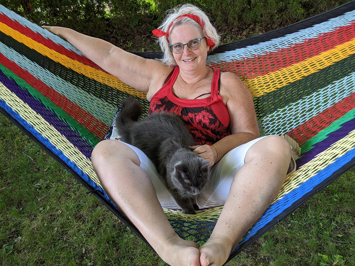 In the backyard photography - on the hammock with a cat