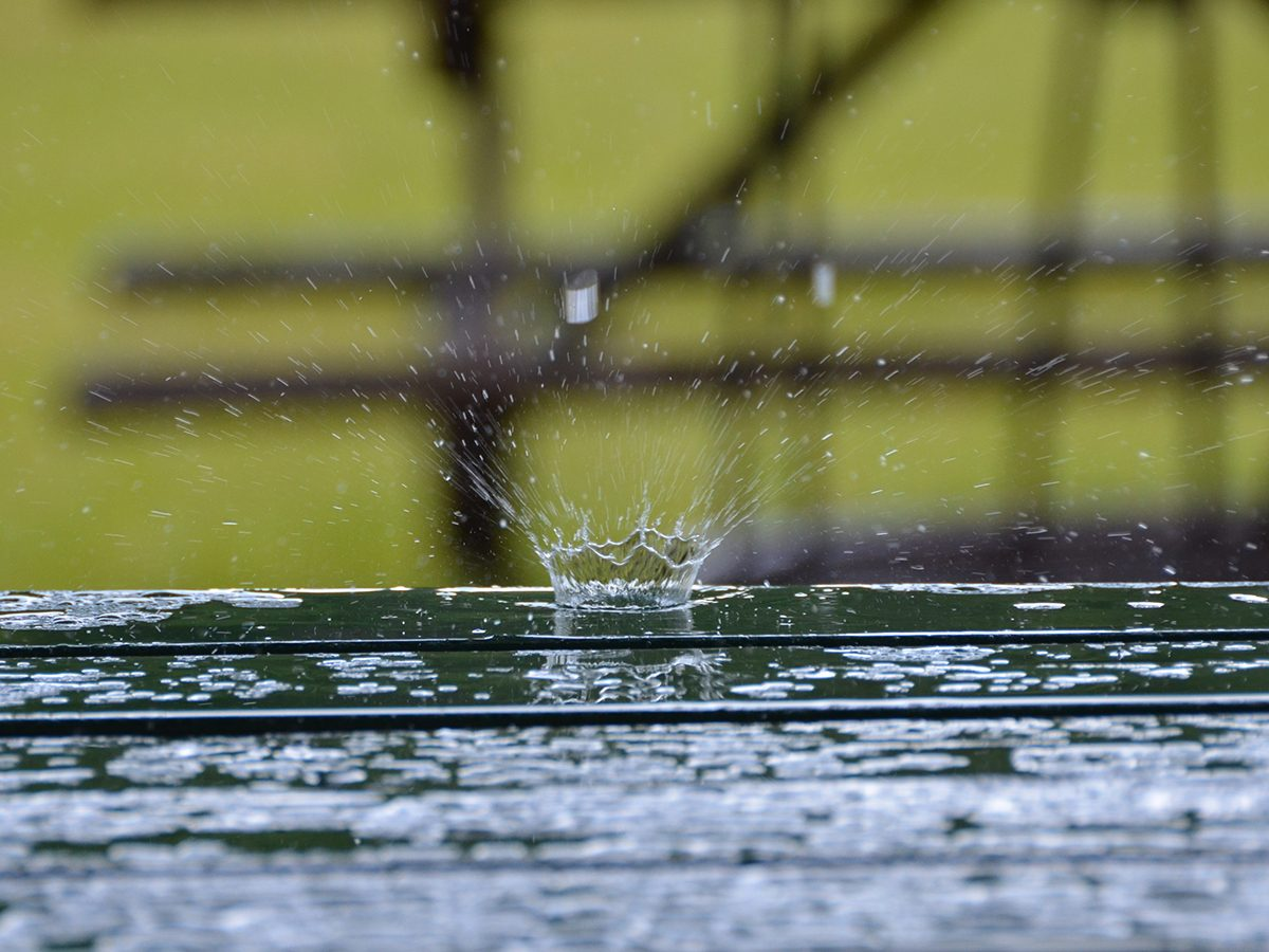 In the backyard photography - raindrop on a picnic table