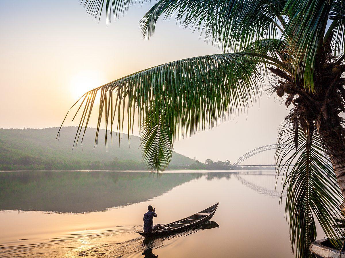 Ghana man paddling boat