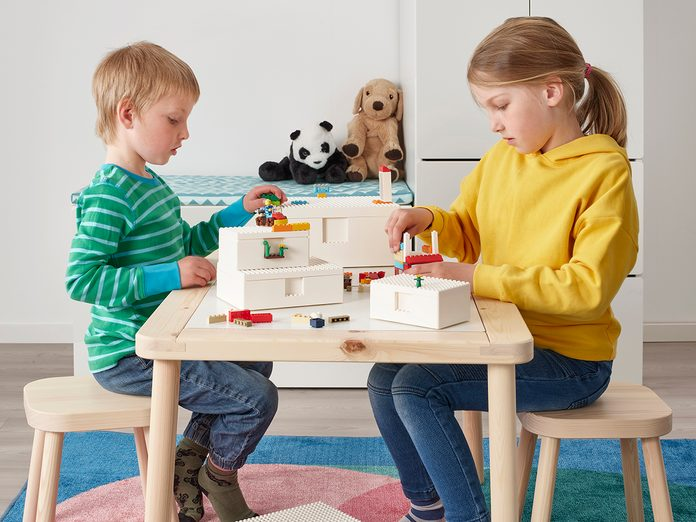 Kids playing with IKEA LEGO Bygglek collection at table