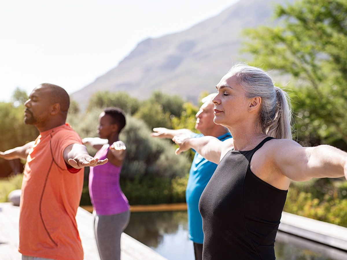 Morning brain exercises - group of people exercising outside