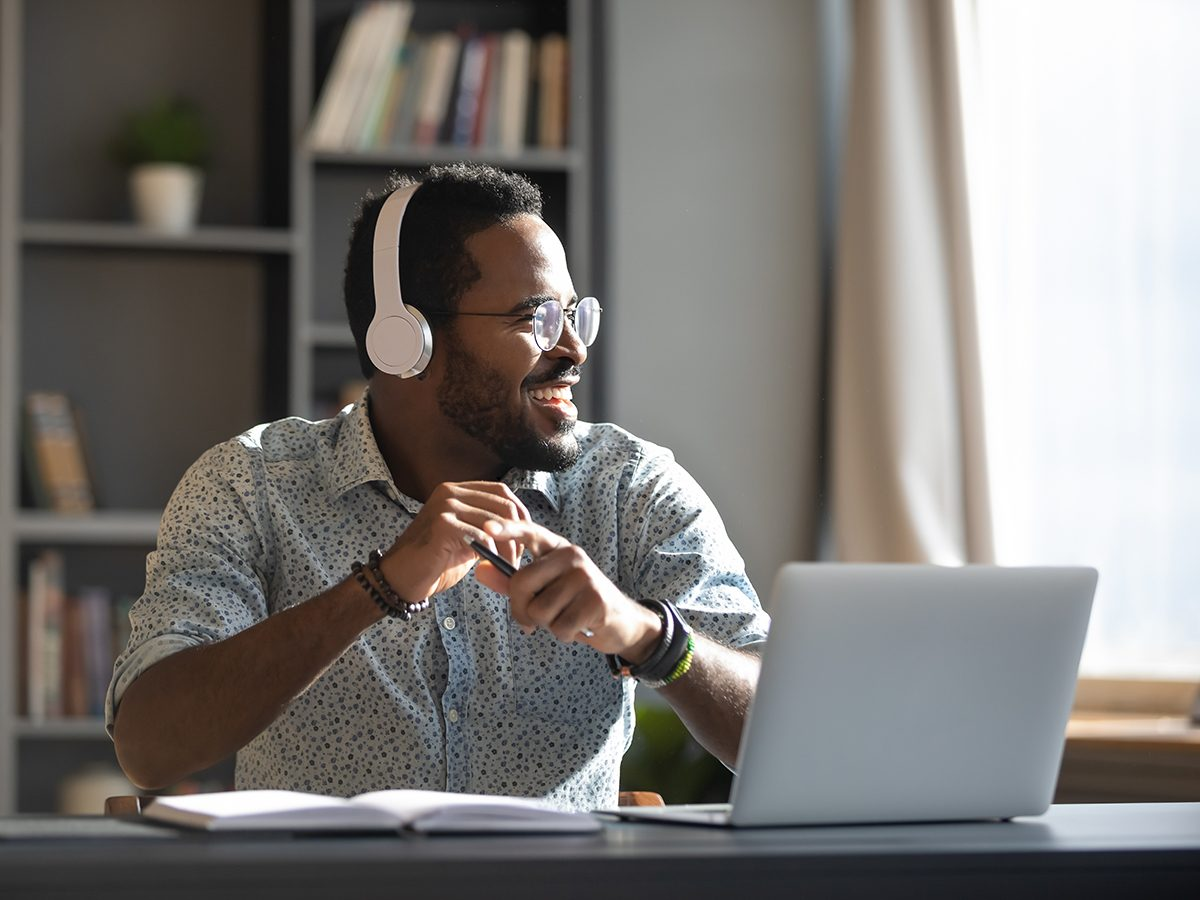 Morning brain exercises - man listening to music with headphones