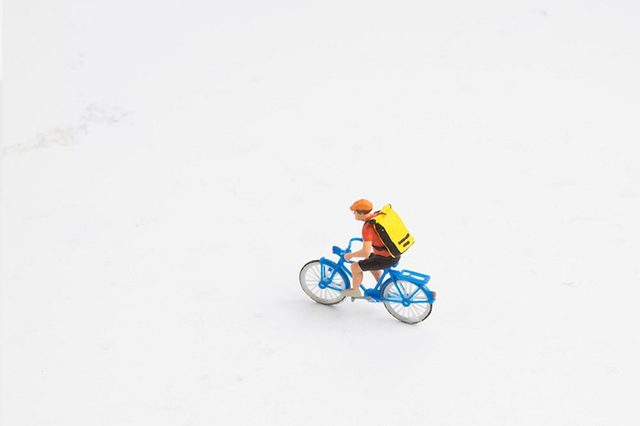 the figure man ride bicycle with backpack on