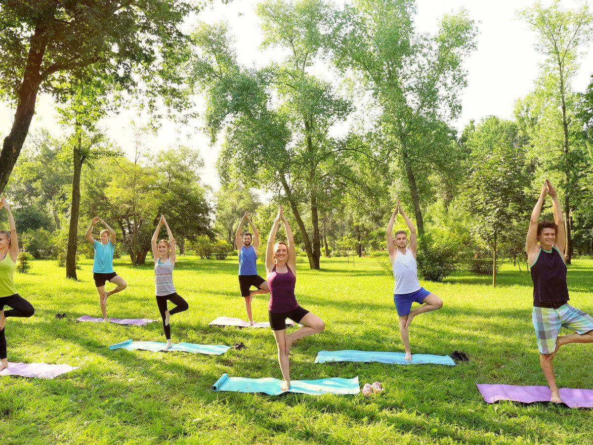 pain management doing yoga in park