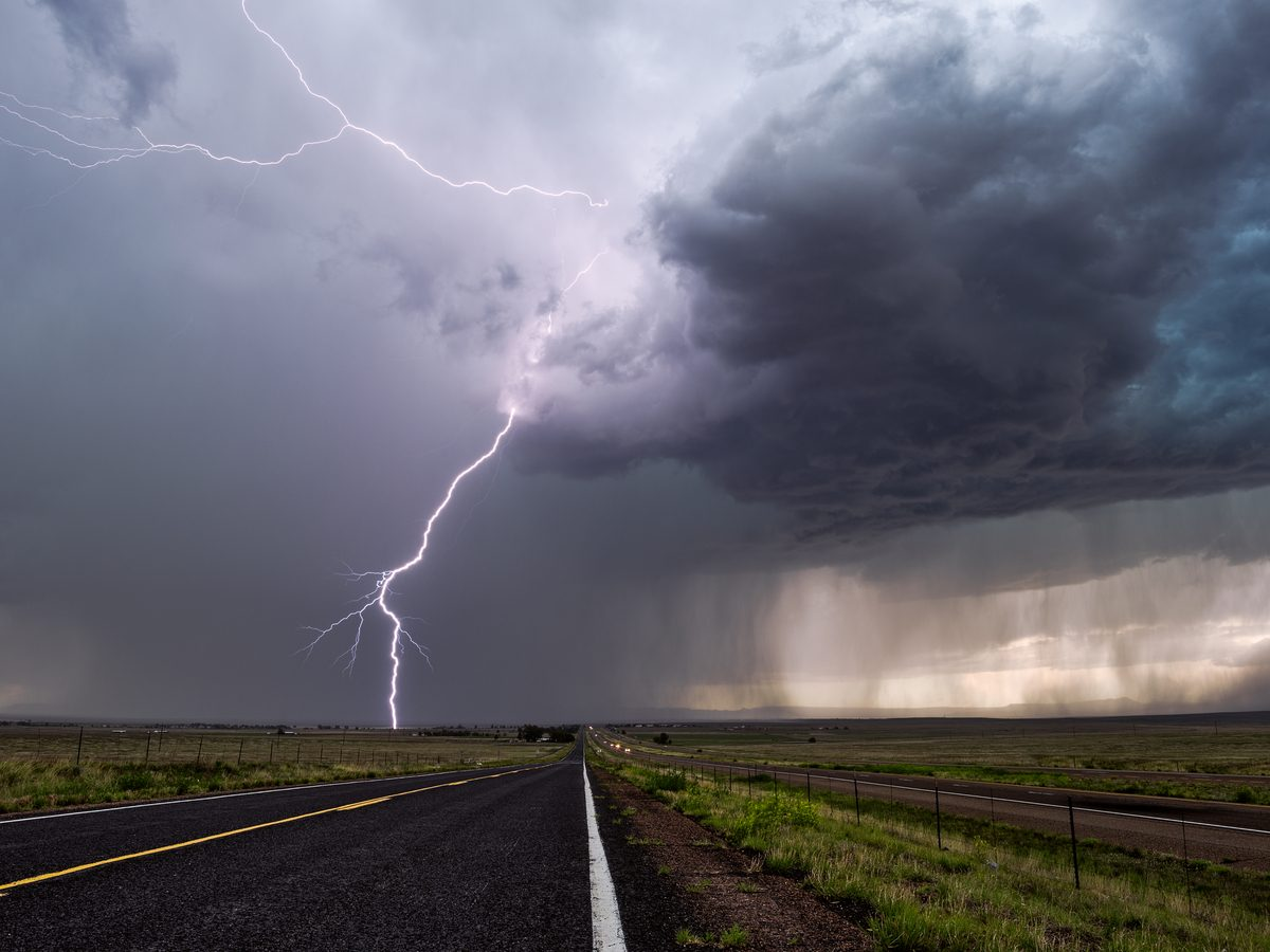 Lightning flash on desolate road