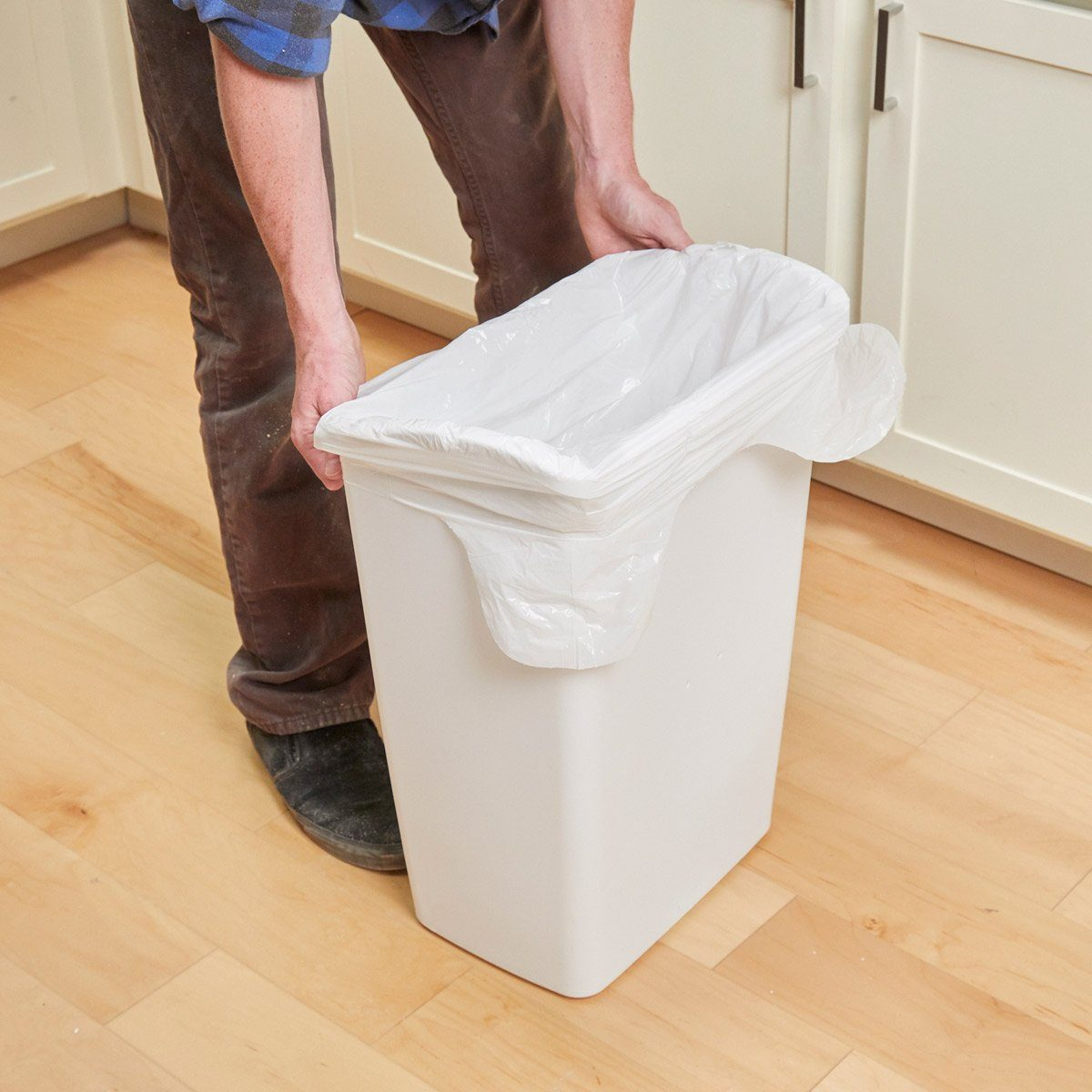 Drill holes in trash can - garbage bag in garbage can