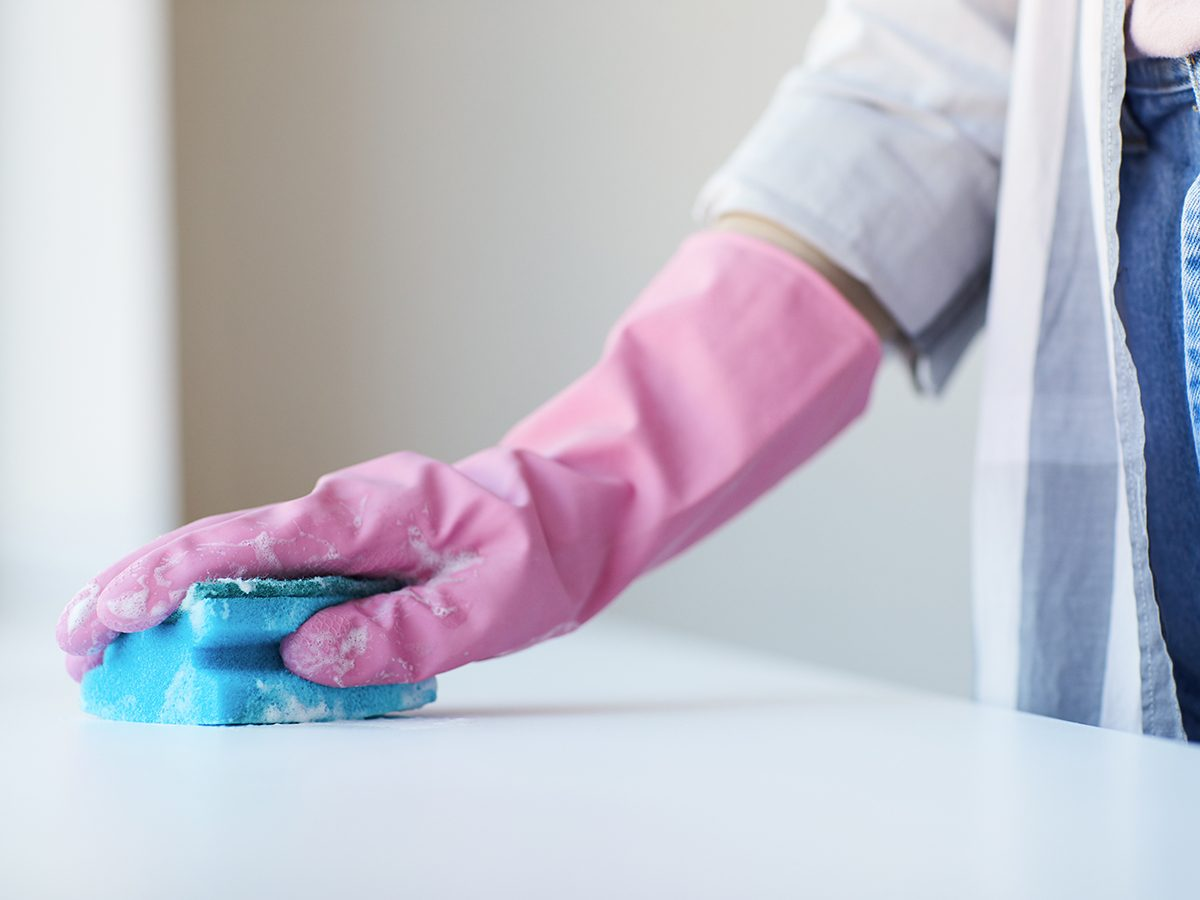 Bad cleaning habits - person wiping surface with sponge