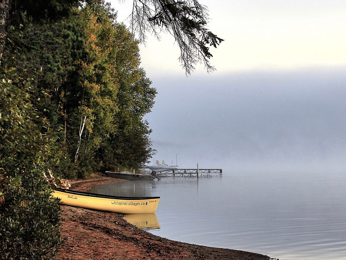 Best boat photography across Canada - Canoes on a beach