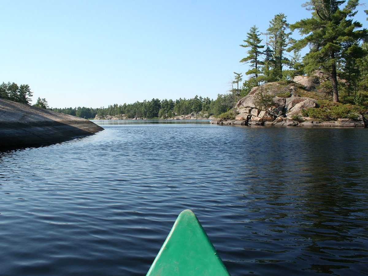 Best boat photography across Canada - Green kayak in Grundy Lake Provincial Park