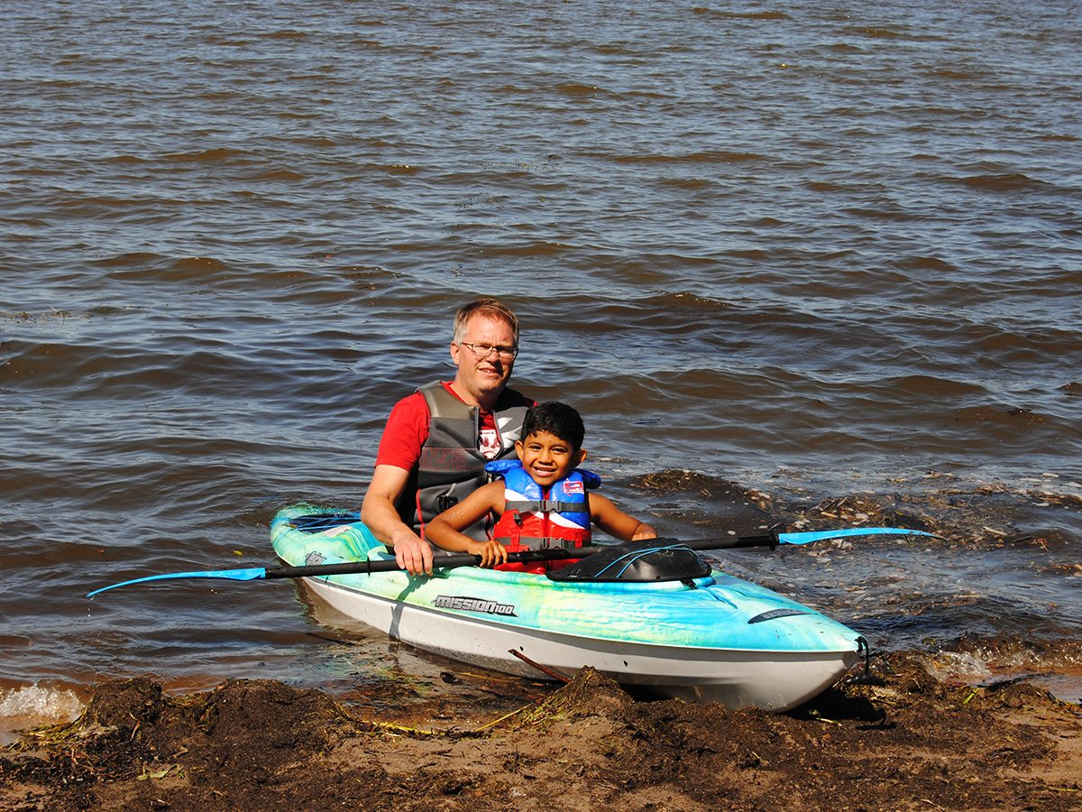 Best boat photography across Canada - man in kayak with kid
