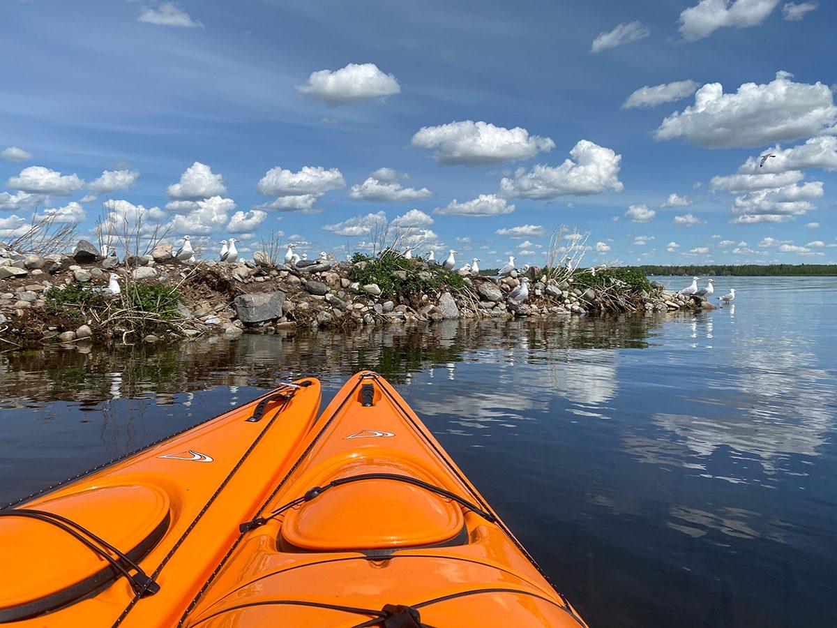 Best boat photography across Canada - Orange kayaks in Alberta