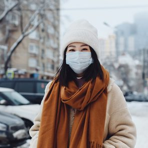 How to prep for COVID-19 this winter - woman wearing mask outside