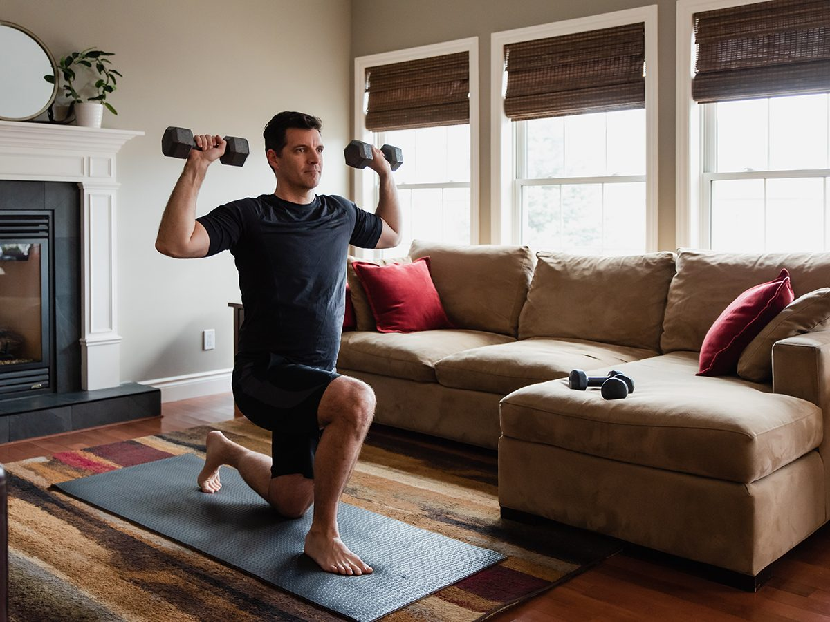 Most likely winter shortages due to COVID-19 - man working out with dumbbells at home
