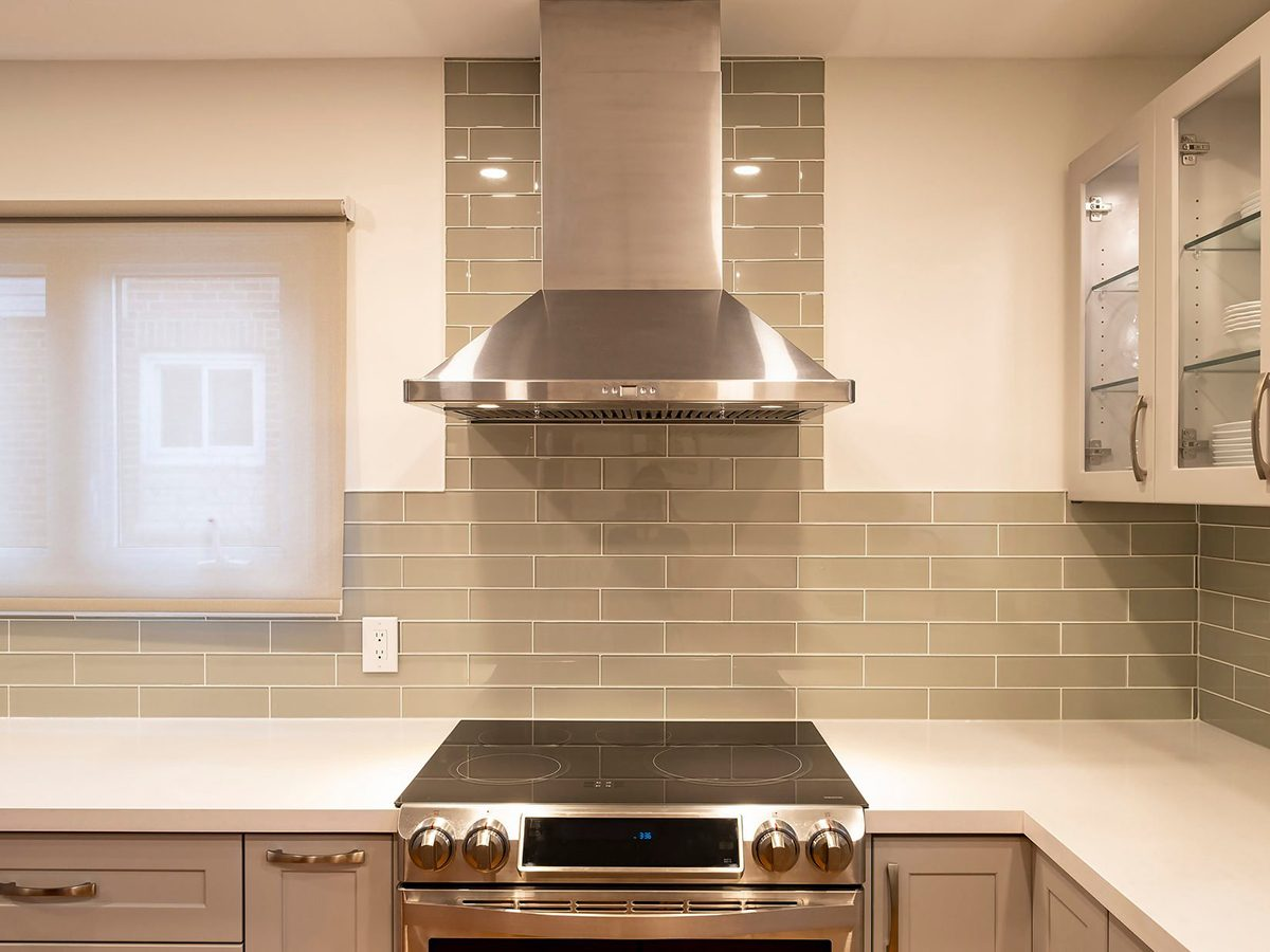 Home fire hazards - New and Modern Open Concept Kitchen with a Grey and White Color Scheme