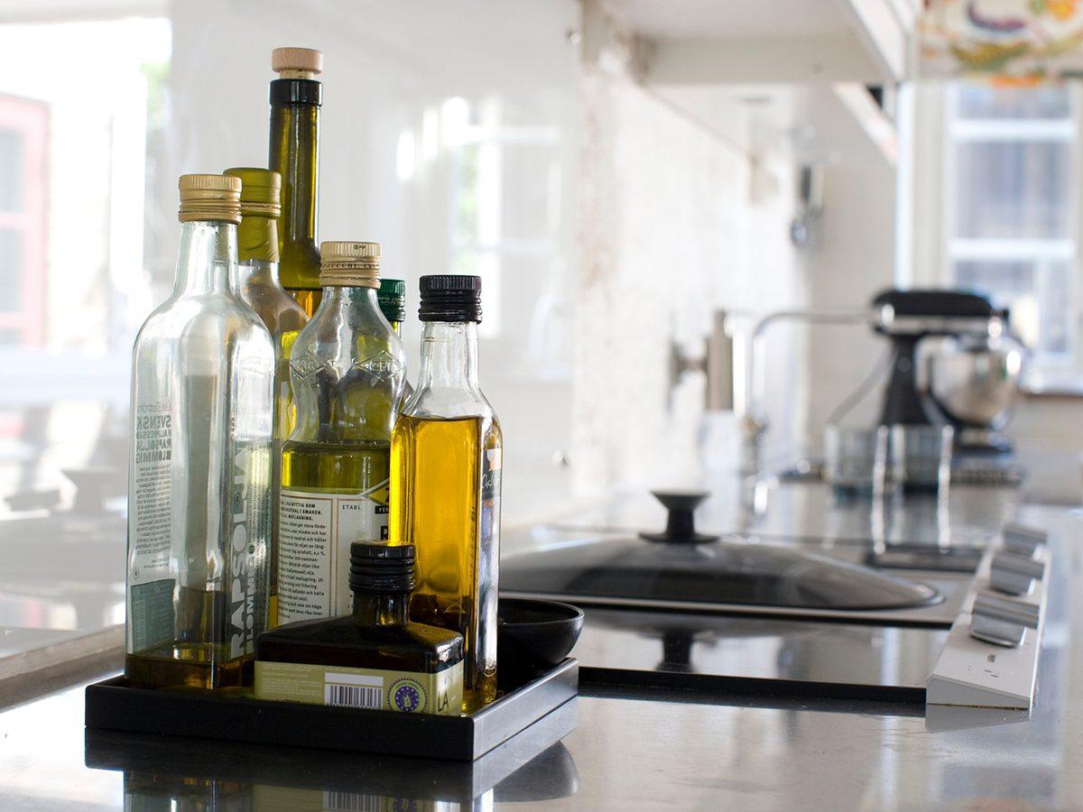 Healthiest cooking oils - oil Bottles on kitchen worktop, close-up