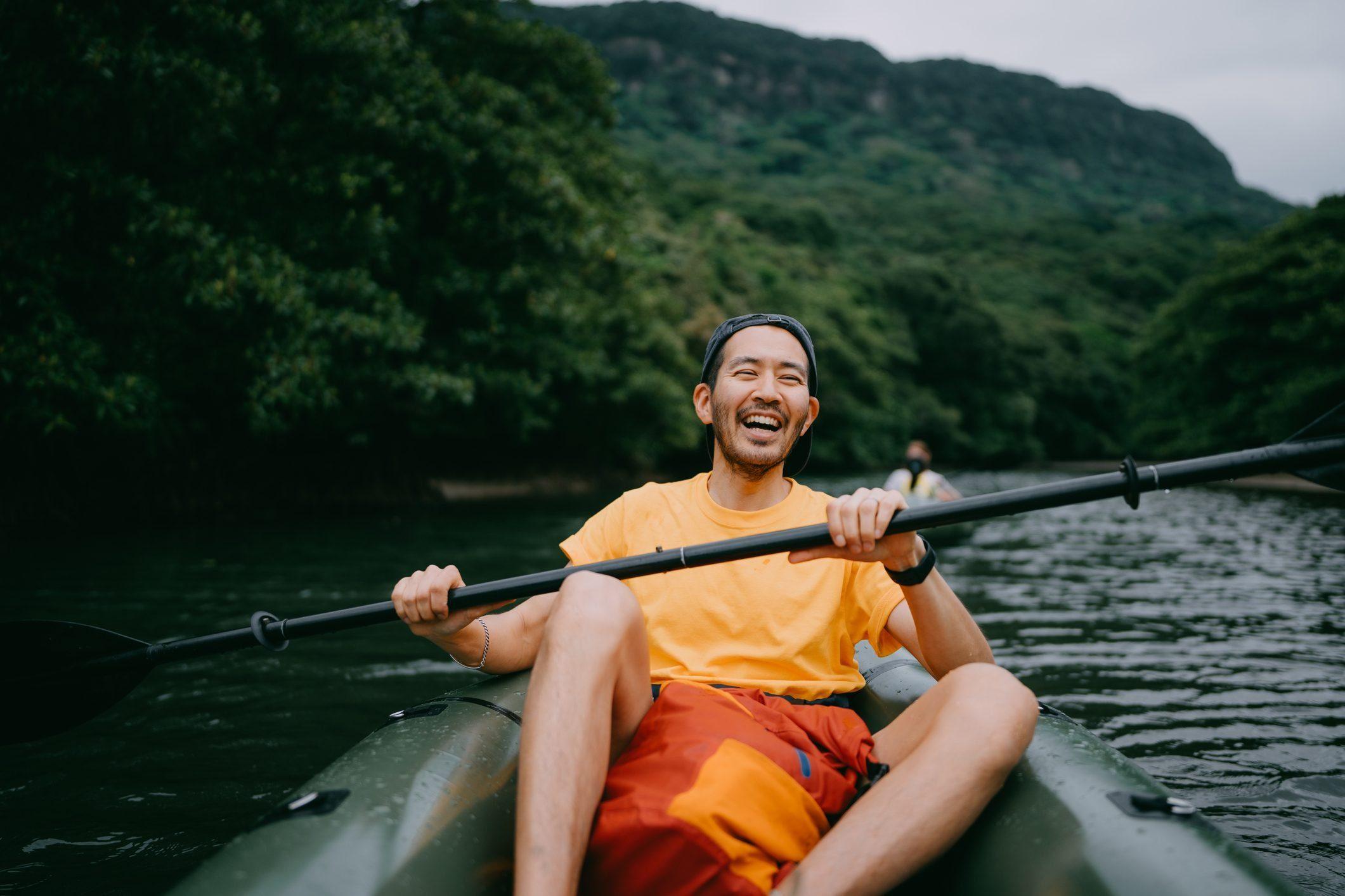 Healthy Booze Alternatives - Man kayaking in river