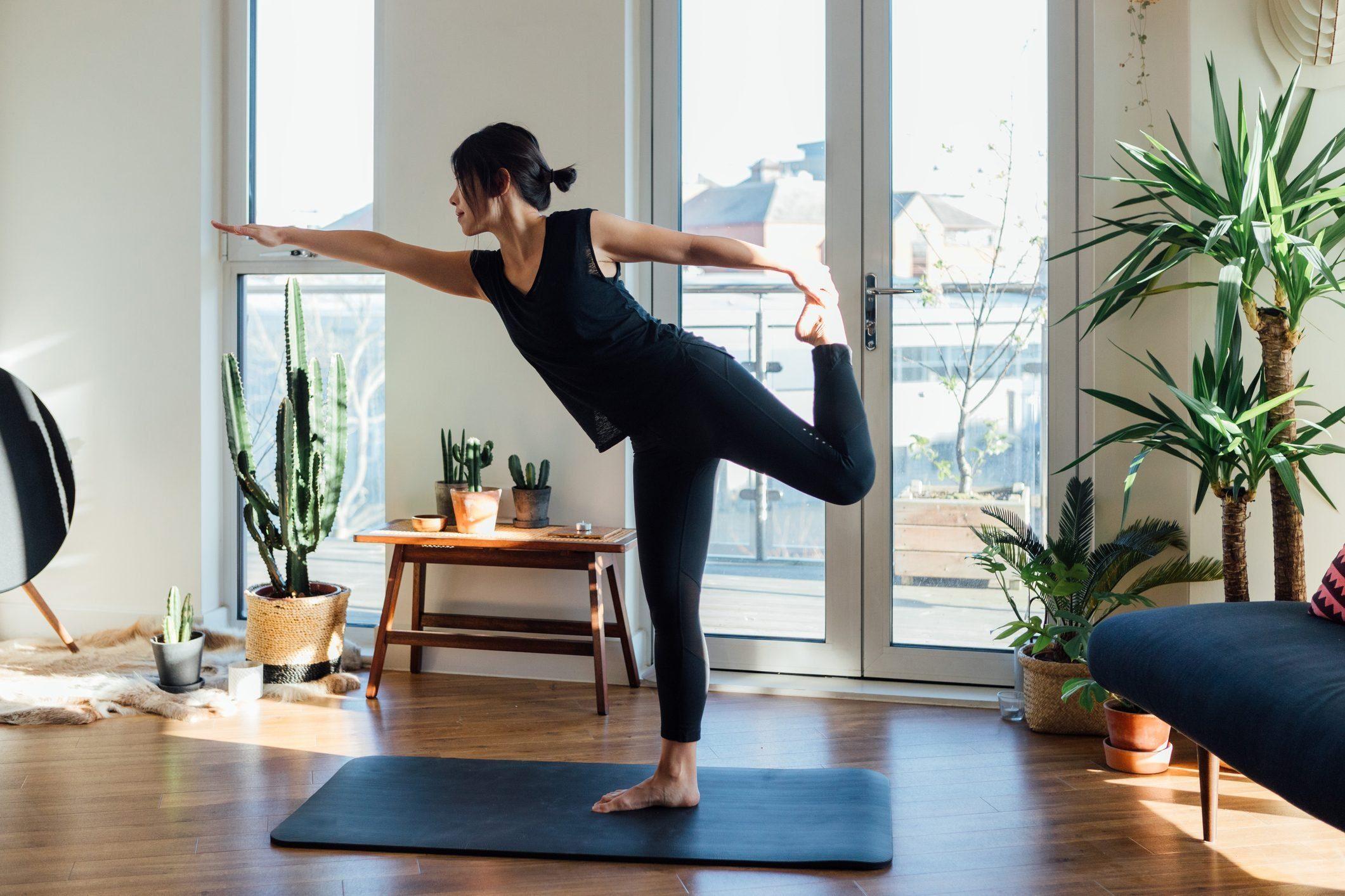 Healthy Booze Alternatives - Woman practicing yoga