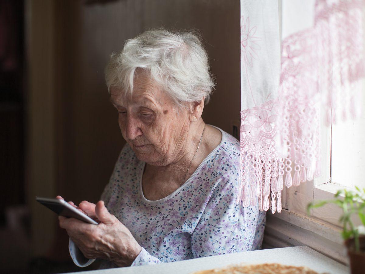 Senior woman using her smartphone