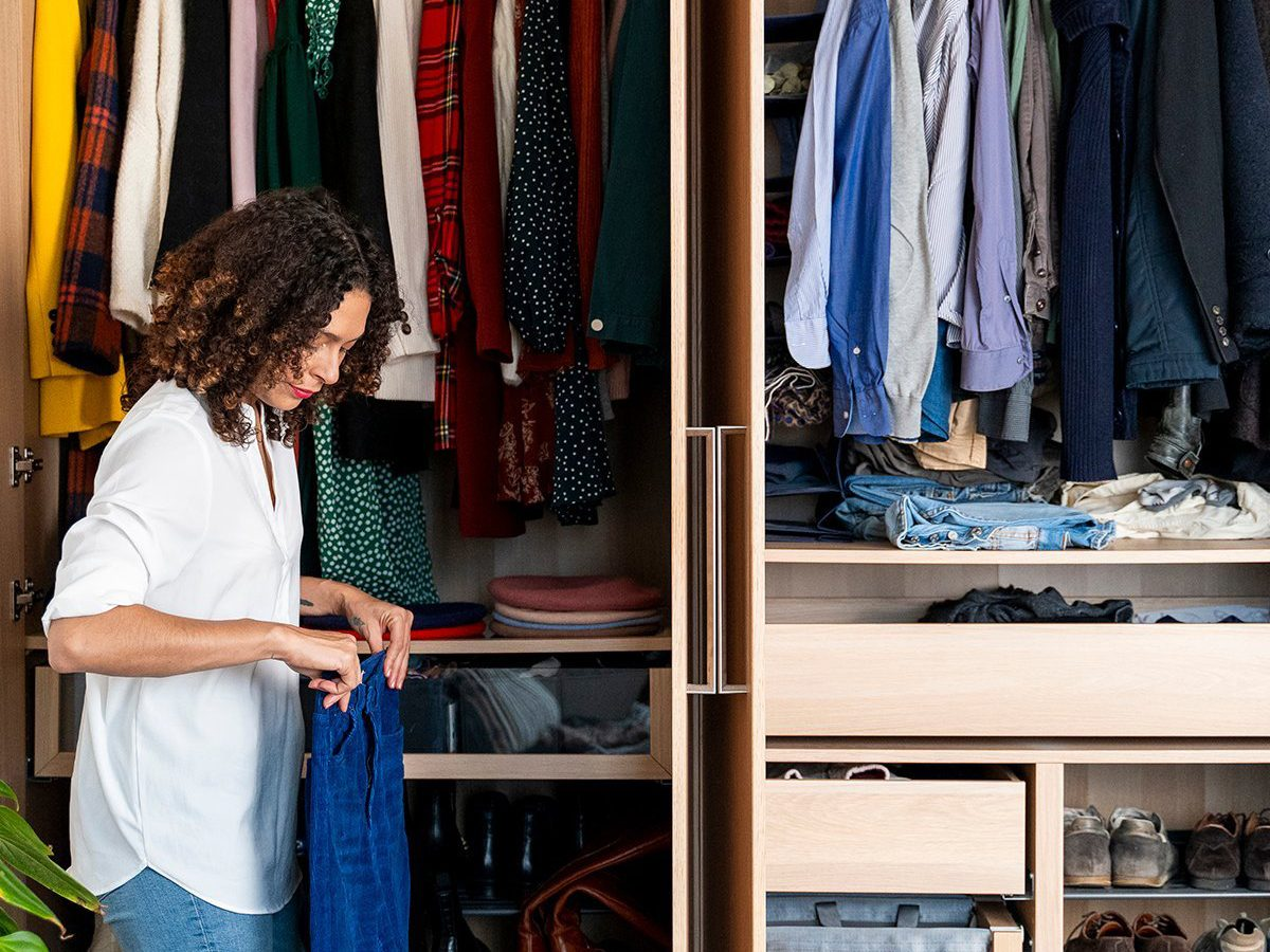 Best chore based on zodiac sign - woman cleaning out closet