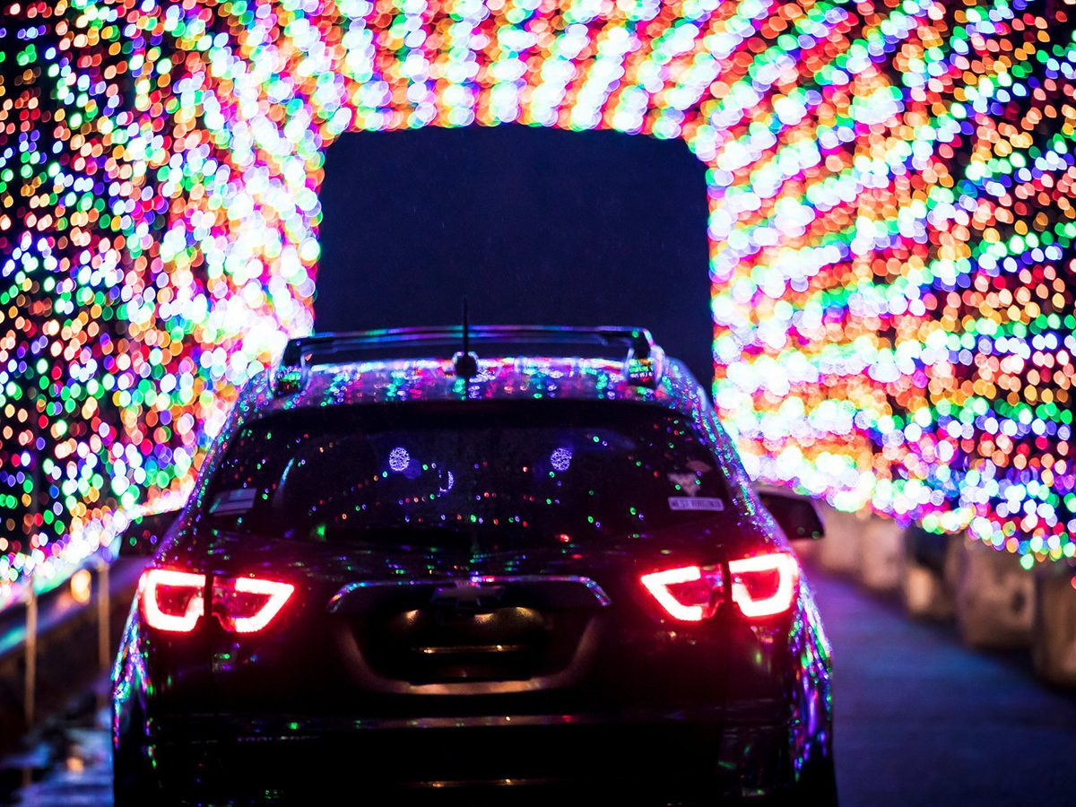 Magic of Lights in Ottawa - Car driving through light tunnel
