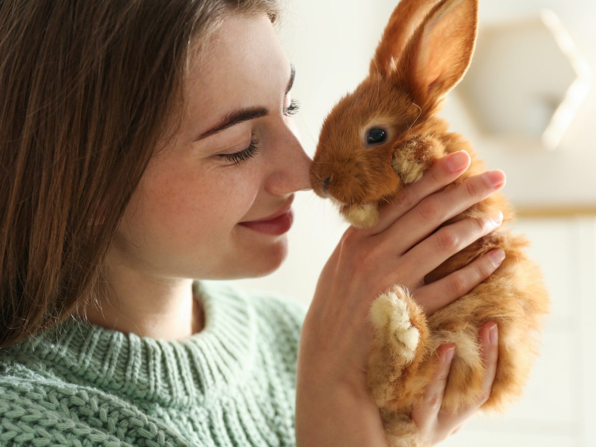 Young woman with pet bunny