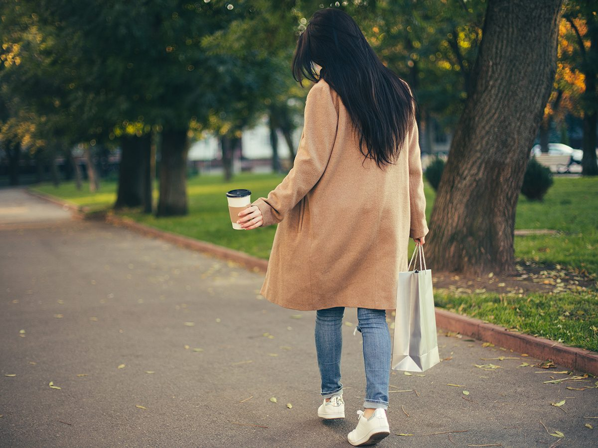 Walking mistakes - Woman walking with bag and coffee