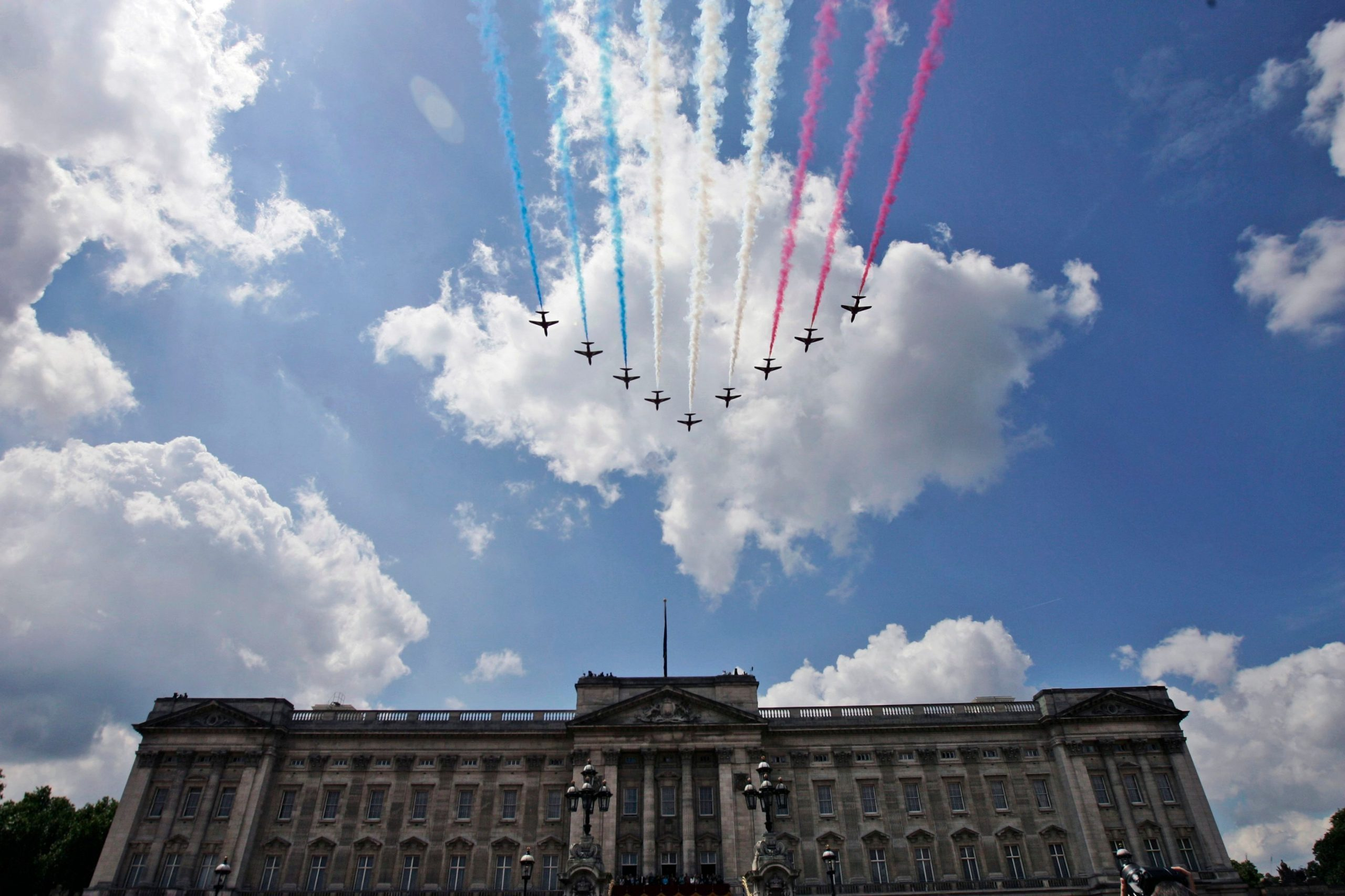 British Royal Air Force Red Arrows jets fly past over Buckingham Palace in central London