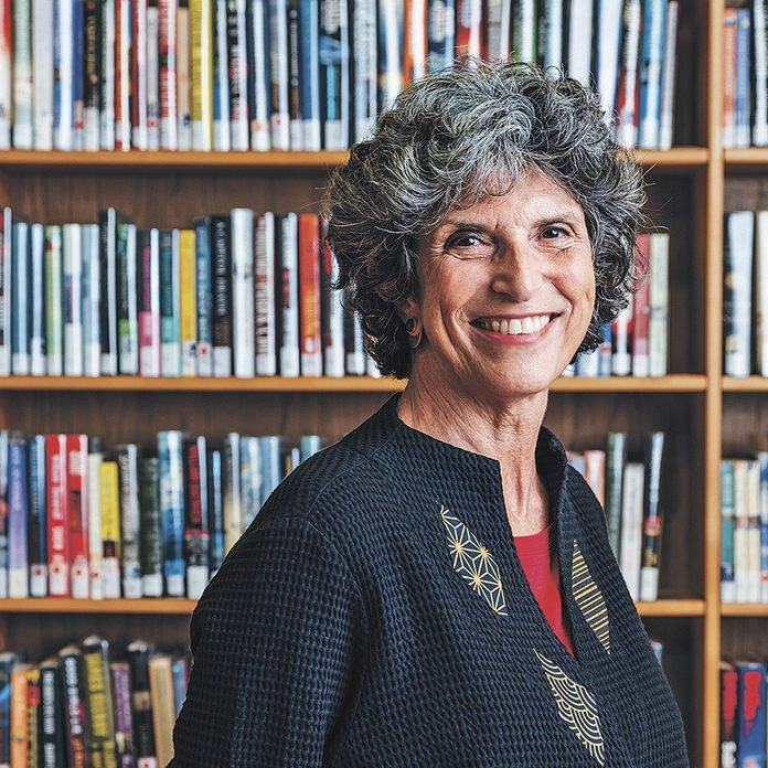 Portrait of Angela Saxe photographed at Tamworth public library in Ontario for Reader's Digest.