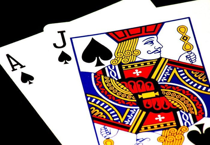 A jack and ace of spades in a deck of cards.