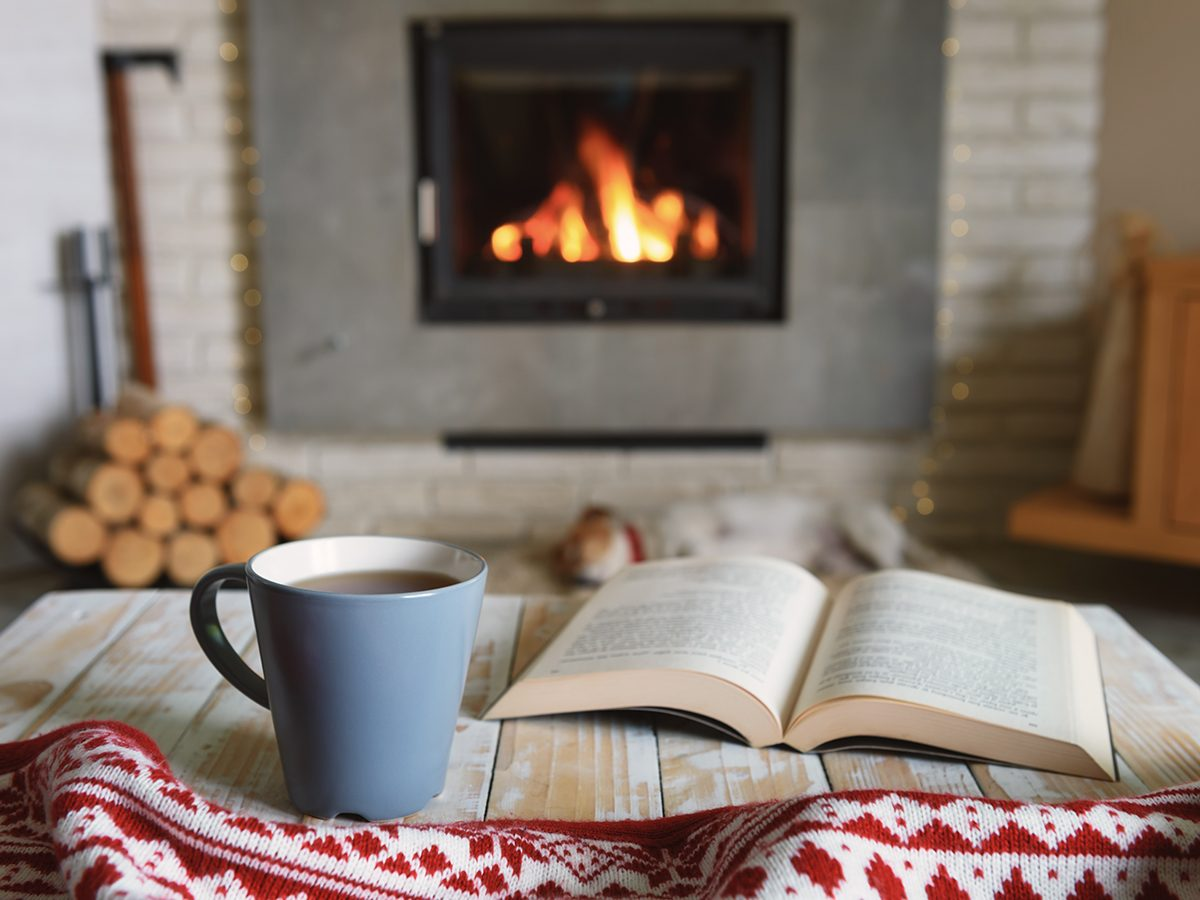 How to make your home cozy this winter - Hygge-inspired room with fireplace