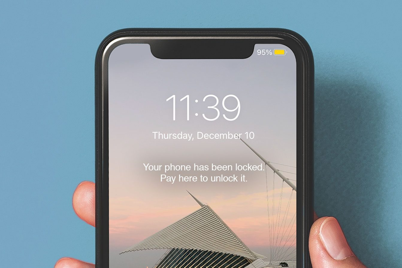 Locked iPhone reading: Your phone has been locked. Pay here to unlock it.