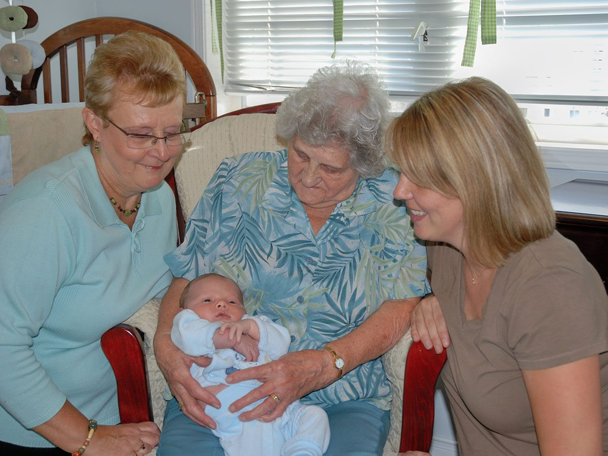 Four generations of a family sitting together