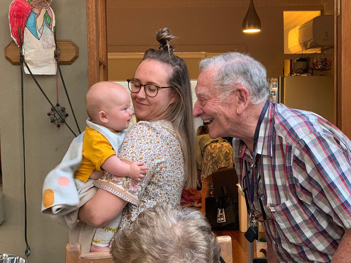 Grandpa meeting new grandchild