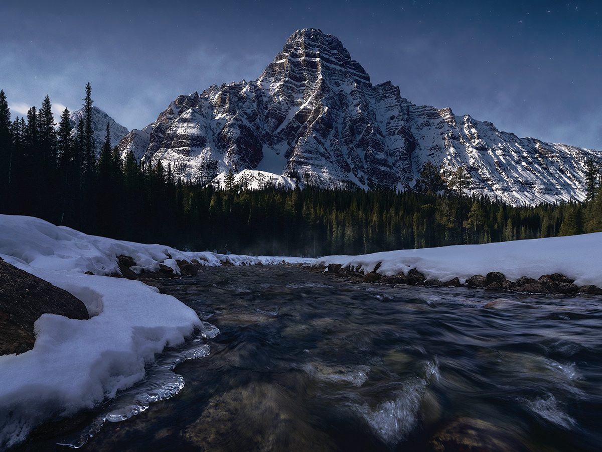 Moon lit Banff rocky mountains.