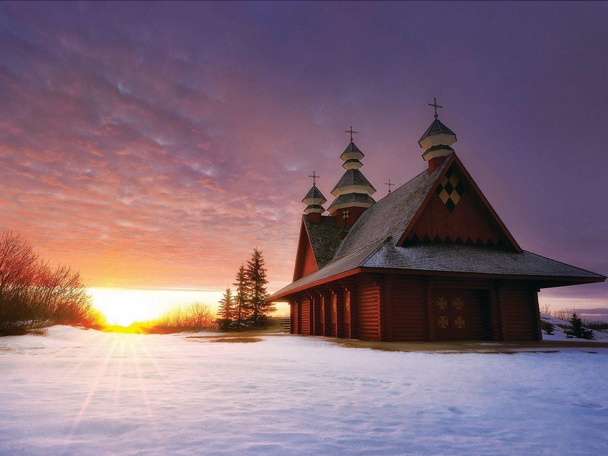 Sunset setting by small Ukrainain Church.
