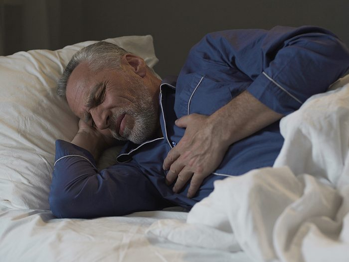 Heart Attack Nap - Man in bed having a heart attack