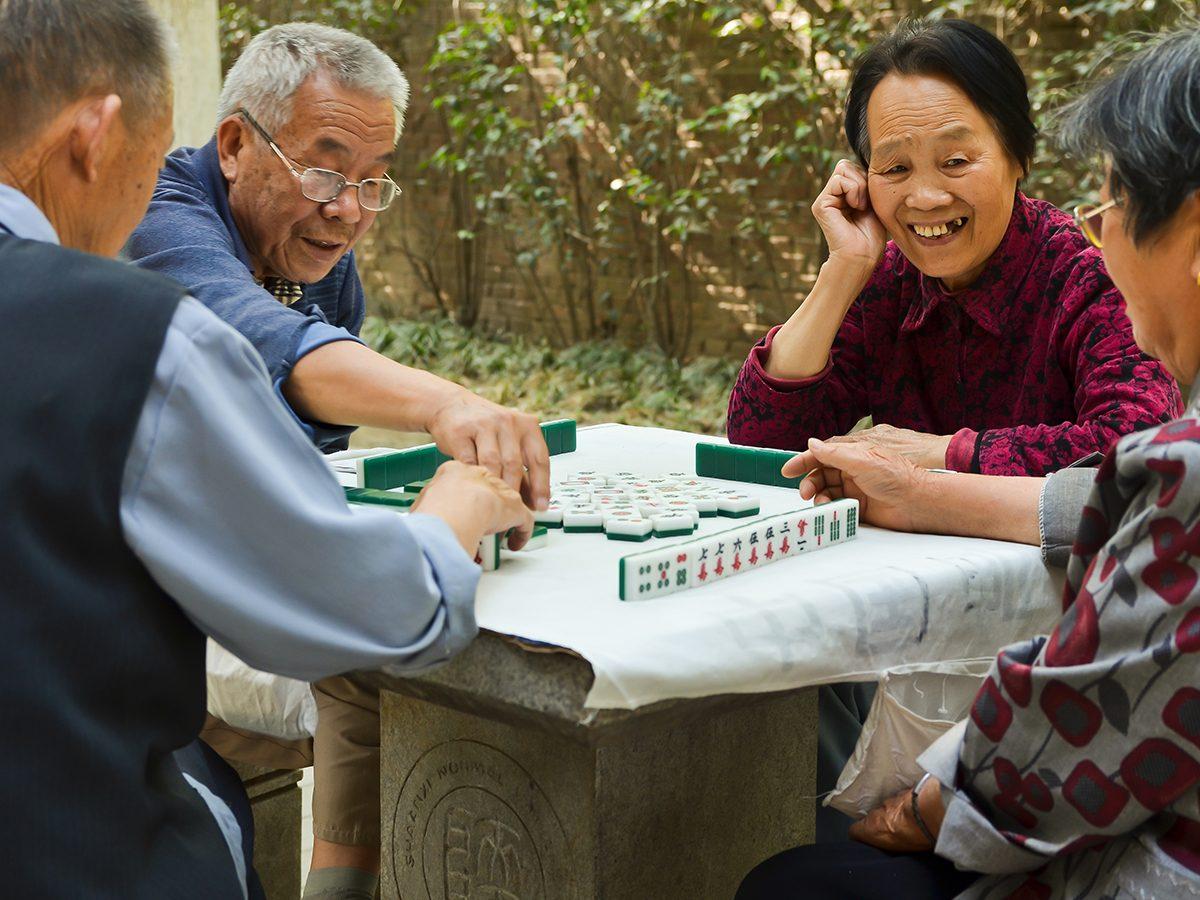 Mahjong Facts - Group of seniors playing mahjong