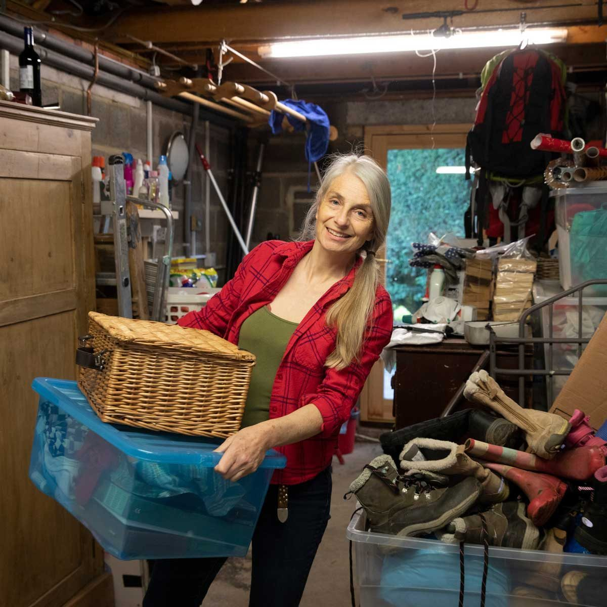 Woman sorting through garage clutter