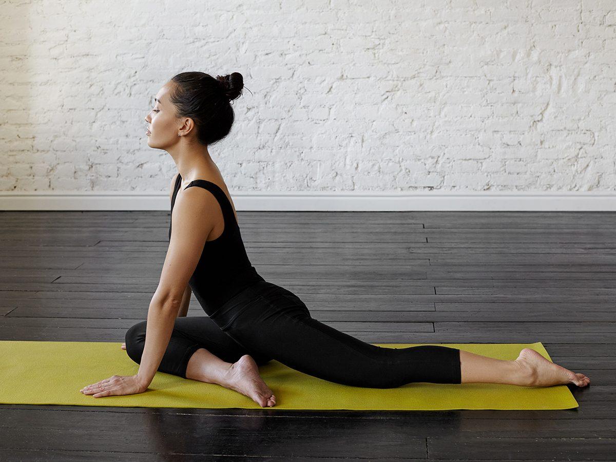 Woman in pigeon pose doing yoga