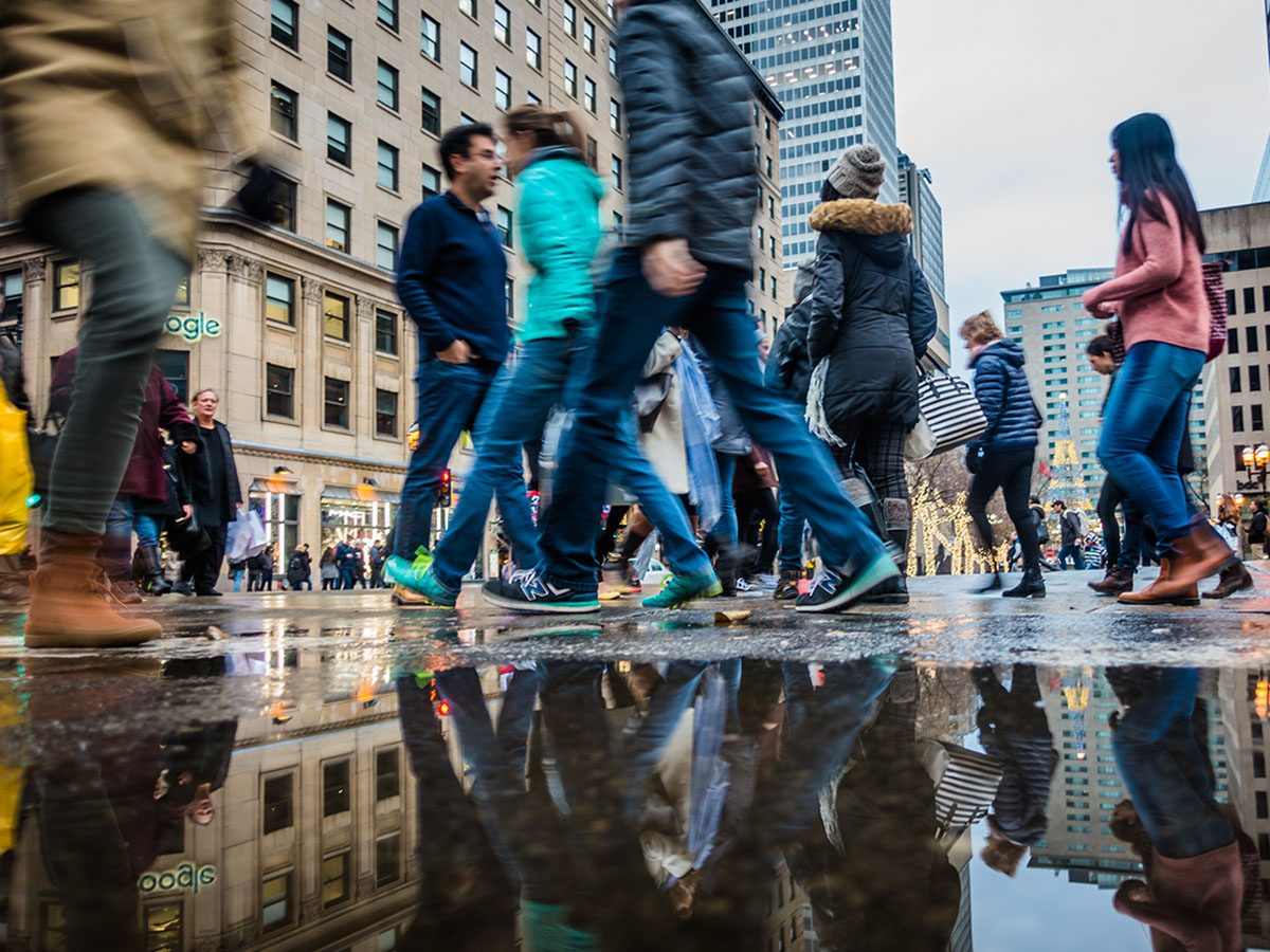People with motion blur walking fast in Montreal, Canada.